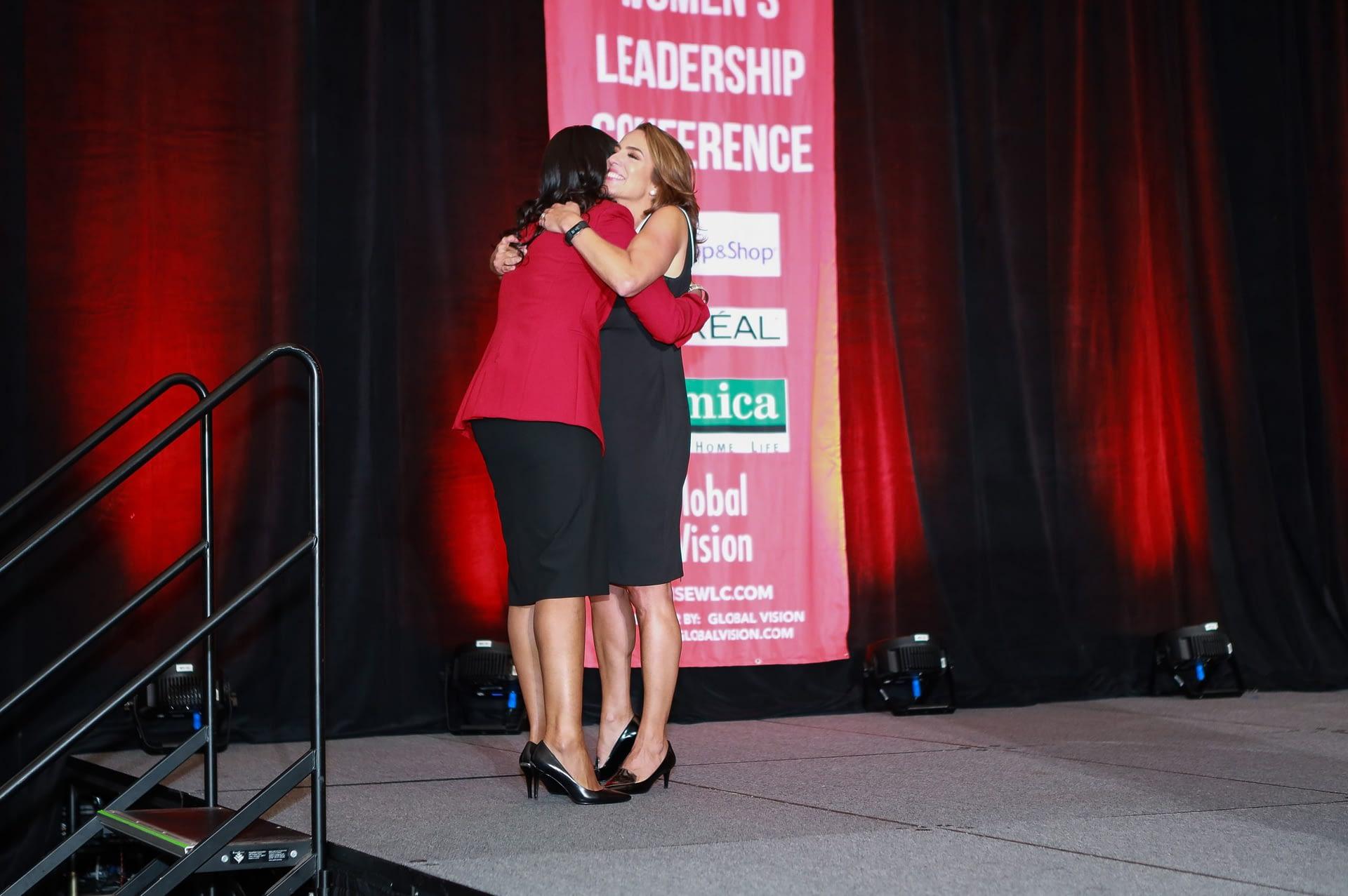host margie and hilina hug